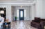 Step inside onto wood-look tile flooring.