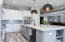 Quartzite counters and professional quality stainless steel appliances.