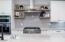 A custom tile backsplash compliments the cabinetry.
