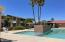 Community pool and heated spa are located steps away!