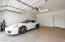 garage with epoxy floors and lots of storage