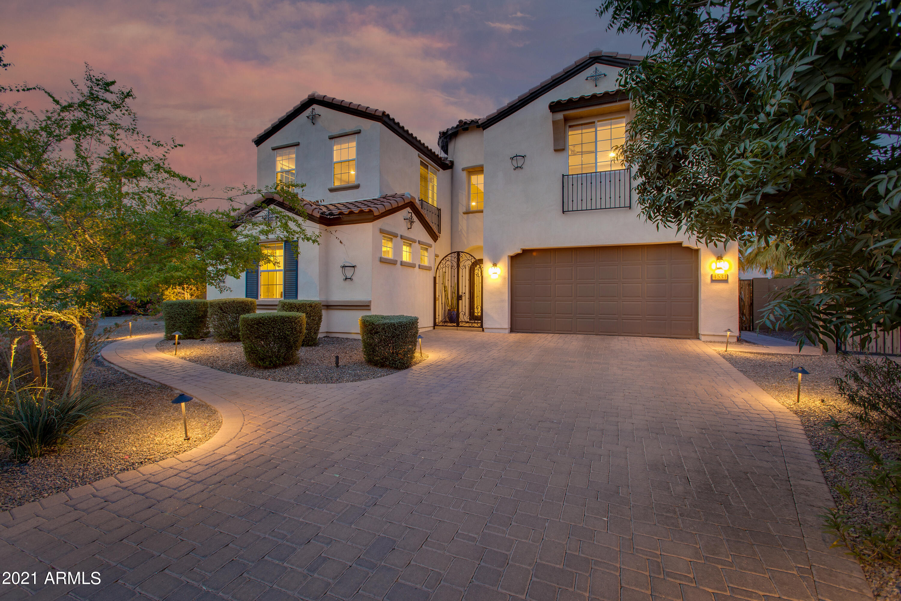 Built in 2015, this immaculate home is nestled between the Biltmore and Arcadia Lite, in the gated community of Madison Vistas. This modern, two-story dream boasts quality finishes at every turn and the open concept is perfect for entertaining guests. The gourmet kitchen features beautiful top-tier appliances, custom cabinetry, and a stunning center island with breakfast bar. First floor includes a 2 room guest suite with kitchenette. On the second floor, you'll find a spacious den/loft, master retreat fit for royalty, and 3 more en-suite bedrooms. The backyard oasis is accessed through a retractable patio wall in the living room and offers a brand new salt-water pool, and a spacious covered patio. With a spacious 2.5-car garage to safely store your cars and fun toys, this home has it all!