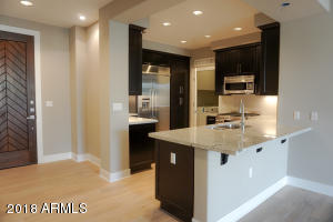 Entry, Kitchen, Breakfast Bar and Laundry