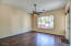 Large master bedroom with views to rear yard and pool