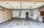 Oversized 2 car garage with lots of cabinets and new water softener located on the left side.