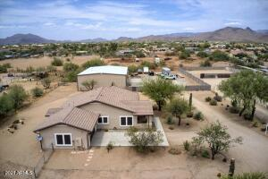 Mountain Views, a charming ranch style home and a massive insulated garage/warehouse space