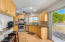 Gorgeous updated kitchen with maple cabinets, stainless steel appliances and breakfast bar
