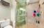 Glass doors in master shower