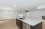 huge kitchen island with quartz countertops