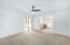 den/office off master suite with built in desk & shelves