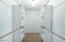 walk in closet with built in shelves & drawers
