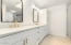 dual vanities with new quartz countertops, cabinets, faucets, mirrors, & lighting