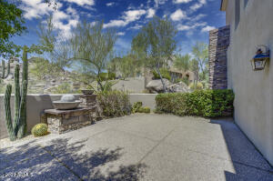 An expansive patio area, highlighted with the desert and boulder outcroppings for views.