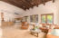 Features Open Beam Ceiling with Great Mountain Views