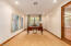 Master Bedroom Sitting Area/Office/Workout area. Separate exit to backyard Oasis.