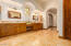 Large Master Bathroom with Dual Vanities and sitting area. 2 Private WC rooms.