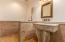 Powder Bathroom with custom Cantera Stone Sink