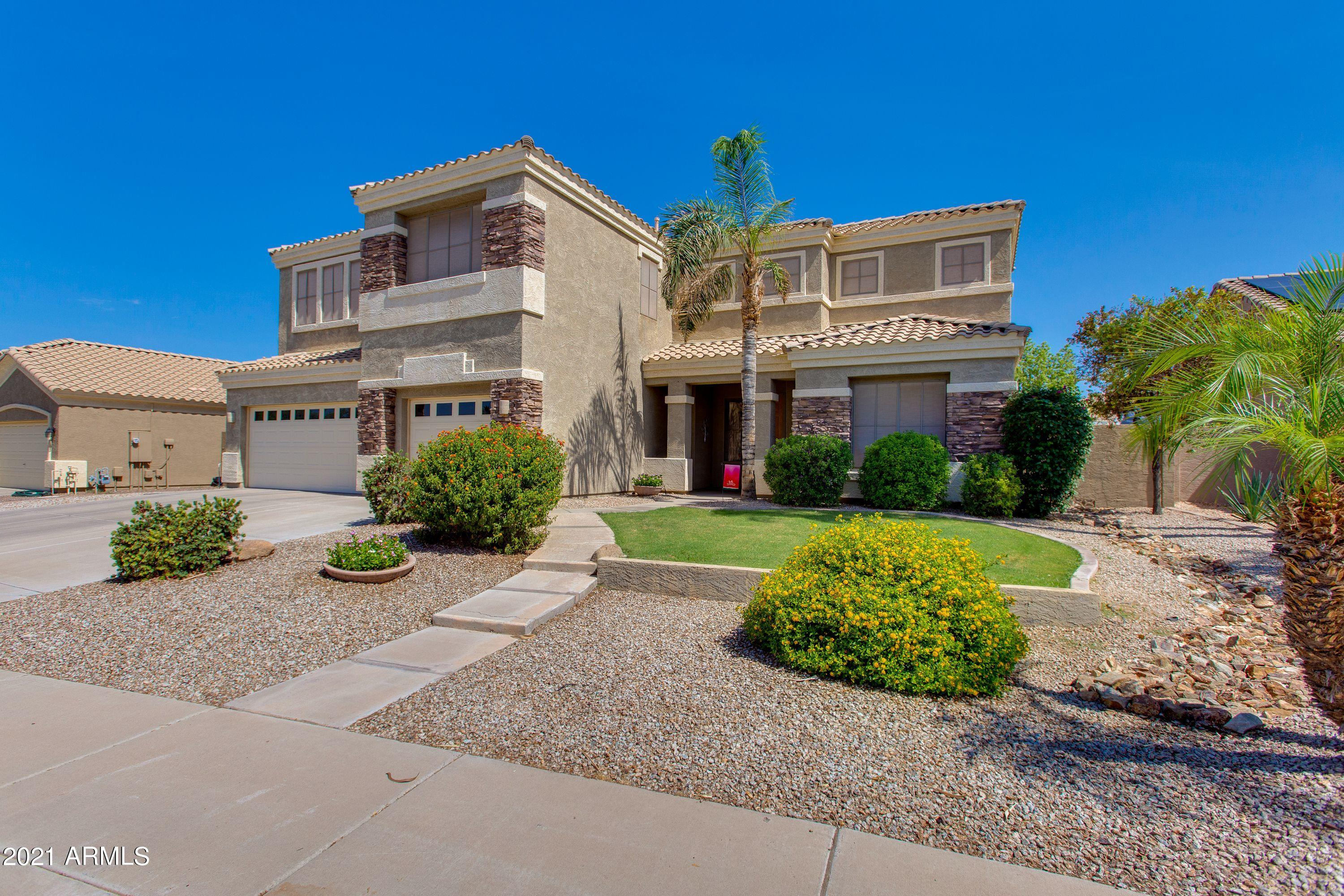 This spacious and beautifully maintained property is located near plenty of great shopping and dining at SanTan Village, as well as Loop 202 Freeway and ASU's Polytechnic Campus. Tucked away in the community of Chaparral Estates, this two story home offers 5 bedrooms, an office, and a loft/flex space. The open eat-in kitchen flows nicely into the family room and features shaker style cabinetry, corian countertops, and a large center island with breakfast bar. With an oversized laundry room and 3 car garage, there is an abundance of interior storage space and built-in cabinetry. Outside in the backyard oasis is where you want to be! Enjoy a covered patio, outdoor kitchen, firepit with seating, lush grass, green foliage, and an inviting Pebble Tec pool and spa. You won't want to miss this!