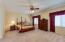 Spacious master with beautiful natural light. Plenty of room to create a private seating area.