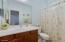 En-suite bathroom to bedroom 5.