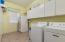Inside laundry room is located downstairs. Plenty of cabinets and second refrigerator perfect for extra food storage.