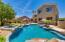 Backyard oasis with pebble tech pool, water feature and spa.