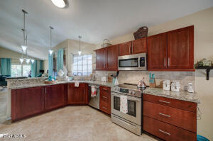 Large Open Kitchen with upgraded cabinetry and appliances.