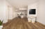 Large Open Concept Living + Dining Splitting Primary Bedroom from Guest Bedroom