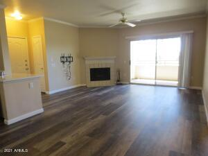 Great room with new flooring, corner fireplace.