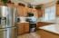 Kitchen with New Glass Tile Backsplash, Stainless Appliances and Corian Counters