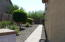 20 foot side yard with paver walkway.