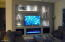 New Dagr Design Art Wall and Fireplace built in 2019. Fireplace can heat in the winter months and change colors to your liking. Lots of storage in the cabinets for video equipment.