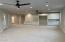 Entertainment room: the rear center door (to the left of the cabinets) leads to the movie room. Full bath is located to the left of the movie room door. Designed to accommodate double refrigerators.