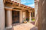 saltillo-tiled front entry courtyard