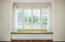 window seat in master retreat with storage drawers