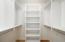 upstairs master suite walk-in closet