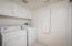 roomy laundry room with pull-down ironing board