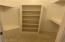 twin walk-in closets in master bath plus another closet
