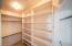 Primary Closet with plenty of organization