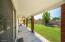 Wonderful oversized patio for entertaining overlooking the natural grass