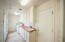 Large laundry room with sink and easy access to the bakyard and storage