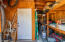 Storage Shed / Workshop. Through that door is an office .