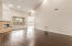 Wood floors, fireplace, huge ceilings, you can set it up to be a formal dining with living room as well, plenty of room