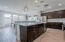 Kitchen features extended cabinets, granite counters, huge island, stainless steel appliances, gas stove and under cabinet lighting.