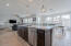 Kitchen features extended cabinets, granite counters, huge island, stainless steel appliances ,gas stove and under cabinet lighting.