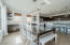 Eat in dining room is flooded with natural light and features built in buffet cabinets and floating shelves