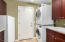 Stackable laundry, rinse sink and upright freezer that conveys with the home