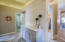 Ample hallway between all four bedrooms has built-in storage with granite countertop.