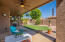 Overlooking the green artificial turf, the extended back patio has two ceiling fans for cooling AND a misting system!