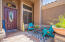 Flagstone entry with cute little courtyard.
